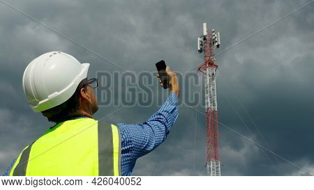 The Telecommunication Engineer While Checking The Signal With The Technician Who Change Spare Part O