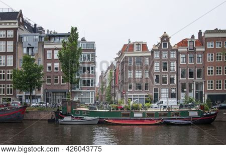 Amsterdam, Netherlands. June 06, 2021. Beautiful View Of Amsterdam With Typical Dutch Houses, Bridge