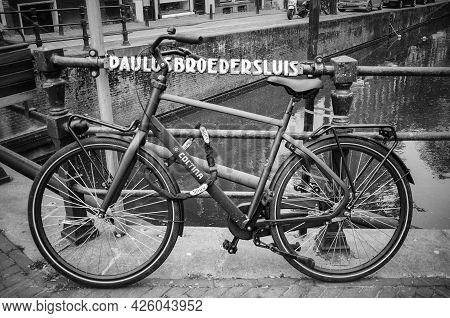 Amsterdam, Netherlands. June 06, 2021. Bicycle Parked On Paulusbroedersluis Bridge