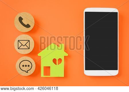 White Mobile Phone With Clipping Path On Touchscreen, Green House Paper Cut And Contact Method Sign