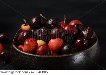 Yellow And Red Sweet Cherries. Fresh Ripe Sour Cherries. Fresh Sweet Cherries Bowl  In Water Drops O