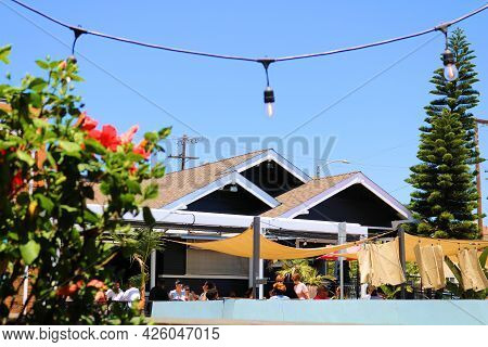 July 6, 2021 In Long Beach, Ca:  Historical Retrofitted House Turned Restaurant With Outdoor Patio S