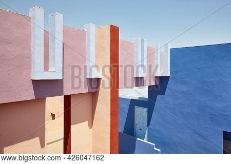 Geometric Colored Building Design. The Red Wall, La Manzanera. Calpe, Spain