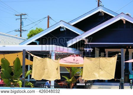 July 6, 2021 In Long Beach, Ca:  Historical Home Retrofitted Into A Restaurant With A Spacious Outdo