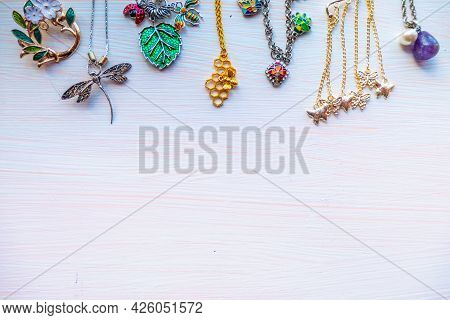 A Lot Of Costume Jewelry Light Summer Bijouterie. Space For Text. High Quality Photo