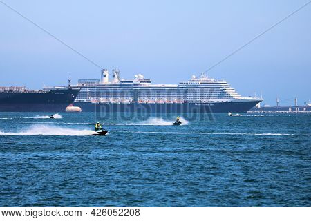 July 6, 2021 In Long Beach, Ca:  People Riding Jet Skis At The Long Beach, Ca Harbor With Anchored C