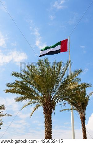 The Flag Of United Arab Emirates Is Near Etihad Museum And Palm Tree