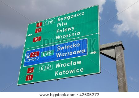Directions sign in Poland showing directions to major city by national roads and a highway: Bydgoszcz Pila Warsaw Wroclaw and Katowice. poster