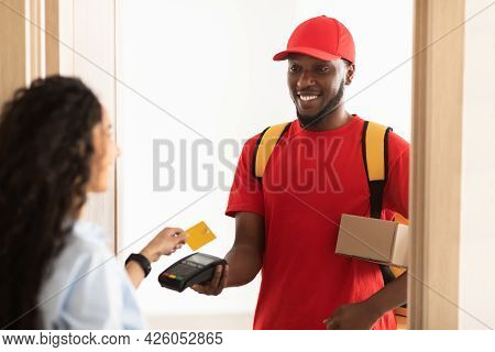 Black Man Holding Pos Terminal Client Lady Paying With Card