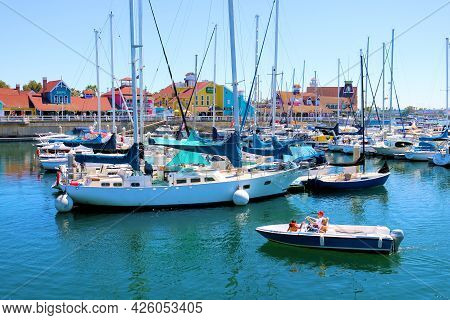 July 6, 2021 In Long Beach, Ca:  People Riding On A Rental Boat At The Long Beach, Ca Marina Surroun