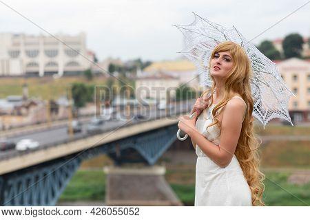 A Girl In A White Dress With White Sun Umbrella