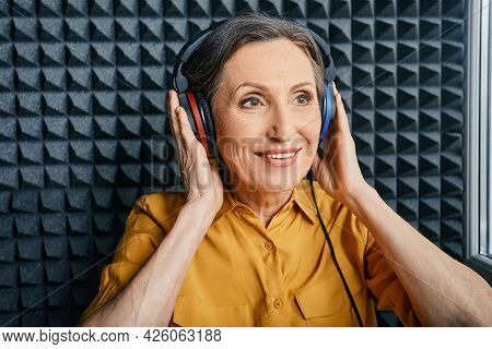 Hearing Test At Senior Woman. Positive Mature Woman During Hearing Exam And Audiometry At Hearing Cl
