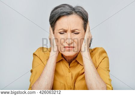 Headache, Stress. Mature Woman With Headache Touching Hands On Temples With Suffering Facial And Eye