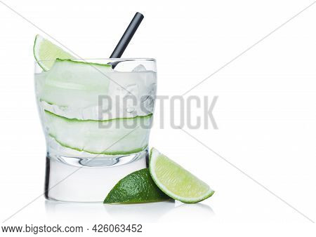 Gimlet Cocktail In Modern Glass With Ice Cubes And Straw, Cucumber And Lime Slice On White Backgroun