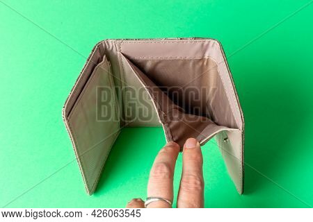 Open Wallet On A White Background. Poverty Concept. Below The Poverty Line.