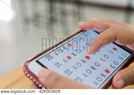 Online E-learning Quiz Exam On Technology Smartphone, Student Clicking Multiple Choice Question. Edu