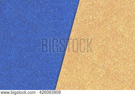 Shiny Textured Background Of Blue And Gold Yellow Paper With Glitters Connected Diagonally In Haze,