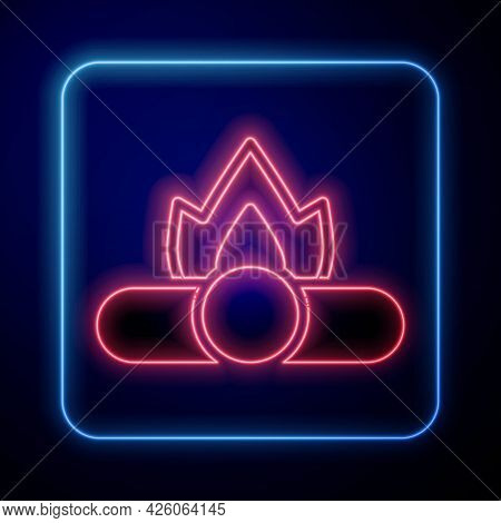 Glowing Neon Campfire Icon Isolated On Blue Background. Burning Bonfire With Wood. Vector