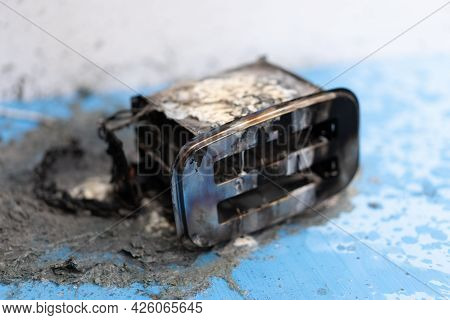 Toaster After Fire. Household Electrical Appliance Fire Hazard. Overload. Short Circuit. Carelessnes