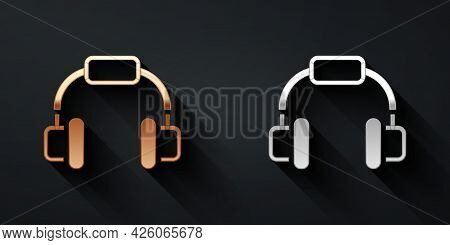 Gold And Silver Headphones Icon Isolated On Black Background. Earphones. Concept For Listening To Mu