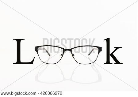 Look, The Text Is Written On The Background Of The Glasses For Sight. Copy Space