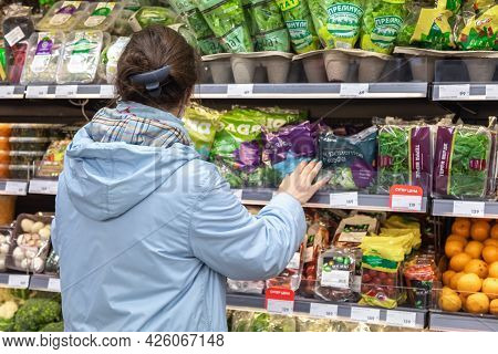 24.04.2021, Russia, Moscow. A Woman Makes Purchases At The Grocery Store. The Buyer Stands At The Wi