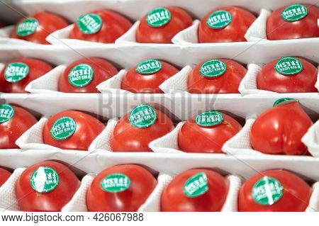 24.04.2021, Russia, Moscow. Large Juicy Varietal Tomatoes With Green Labels On The Side Lie In A Box