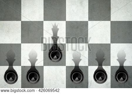 Black Pawn With The Shadow Of The Queen, In Front Of The Pawns. Top View. Leadership Concept. Streng