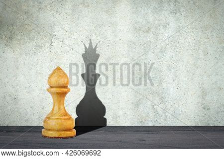 White Pawn With The Shadow Of The Queen. Motivation Concept. Strength And Aspirations. Confidence In