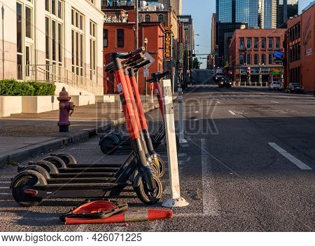 Nashville, Tennessee - 28 June 2021: Spin Electric Scooter On Roadside Near Broadway And Downtown En