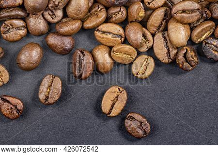 Coffee Beans On A Black Background Close Up