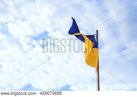 The Blue-yellow Flag Of Ukraine Develops Against The Background Of Sky. Constitution Day, Flag Day,