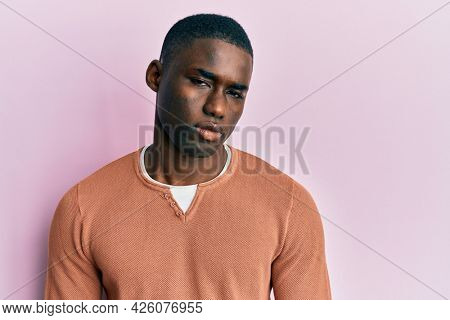 Young african american man wearing casual clothes skeptic and nervous, frowning upset because of problem. negative person.