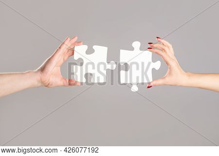Holding Puzzle. Closeup Hand Of Connecting Jigsaw Puzzle. Business Solutions, Success And Strategy C