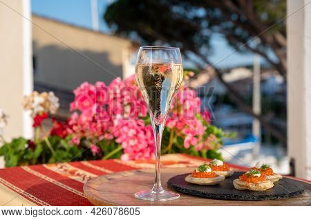 Drinking Of White Cold Champagne, Bliny With Red Caviar And View On Port Grimaud Near Saint-tropez I