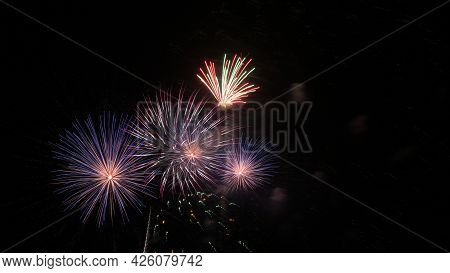 Fireworks Exploding In The Night Sky On Fourth Of July