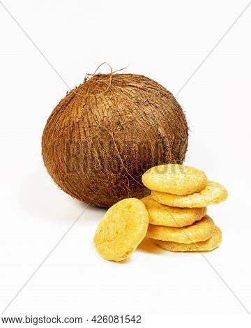 Vertical Composition With Isolated Homemade, Organic, Coconut Cookies With A Whole Coconut On A Whit