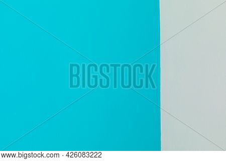 The Background Of The Wall Is Homogeneous With A Vertical Division Of The Surface Coloration Of Blue