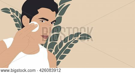 Man Cleaning Face Skin With Batting Cotton Pads. Beautiful Young Man Cleaning Face Using Cotton Pad.
