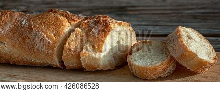 Banner With Sliced Baguette On Cutting Board. Fresh Baguettes Detail Images. Crusty Ciabatta Bread S