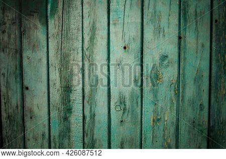 Green Wood Texture Background .old Ragged Painted Fence.
