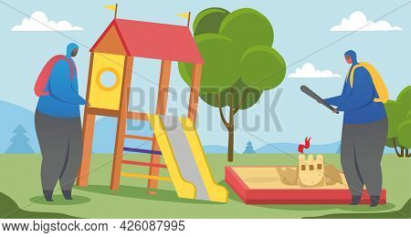 Street Gangsters And Vandalism Concept. Two Masked Teenagers Destroy A Playground In A Public Park.