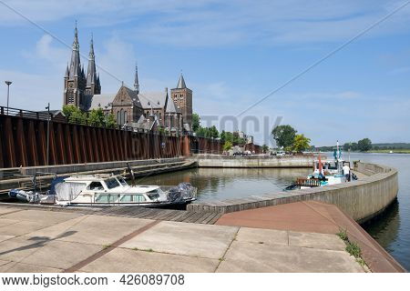 Cuijk, The Netherlands - June 18, 2021: Dutch Village Cuijk Along River Meuse With Harbor And View A