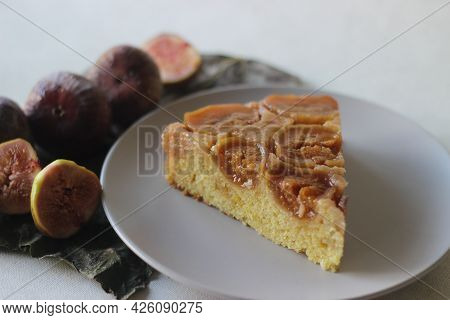 Slice Of Fig Upside Down Cake With Lots Of Fresh Figs And Flavored With Fresh Orange Juice.