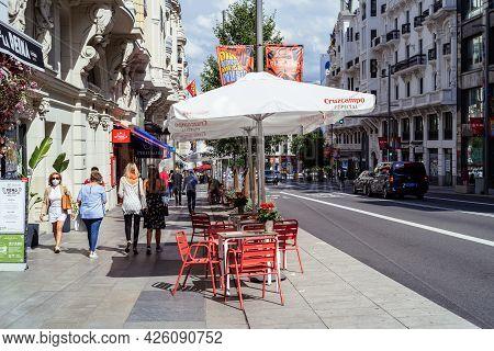 Madrid, Spain - June 18, 2021: Sidewalk Cafe With Umbrellas In Gran Via, The Iconic Avenue Of Madrid