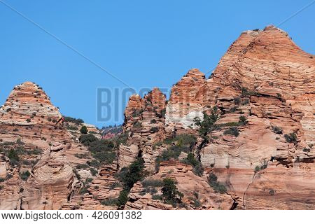 Ancient Sandstone Rock That Has Been Eroded By Time Into Circular Swirling Patterns With A Blue Sky