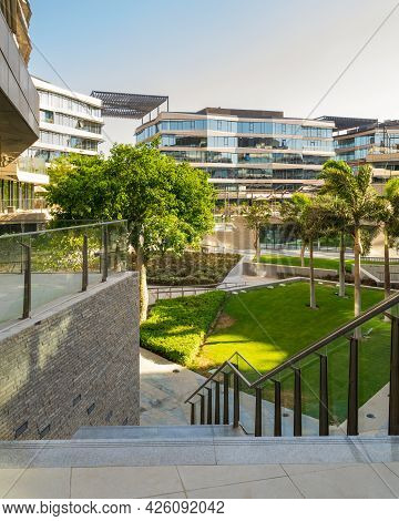 Marble Staircase And Glass Handrail Leading To Street In Contemporary Urban City District With Well