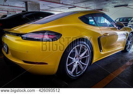 Bangkok, Thailand - 26 Jun 2021 : Close-up Of Rear Light Or Tail Lamp, Wheel And Door Of Yellow Ferr
