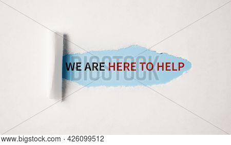 We Are Here To Help Concept. Helpdesk Support Slogan Under Uncovered Beige Paper.