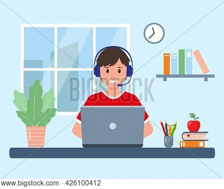 Pupil With Laptop Studying Online At Home In Room Near Window. Happy Smiling Boy Doing Homework Or O
